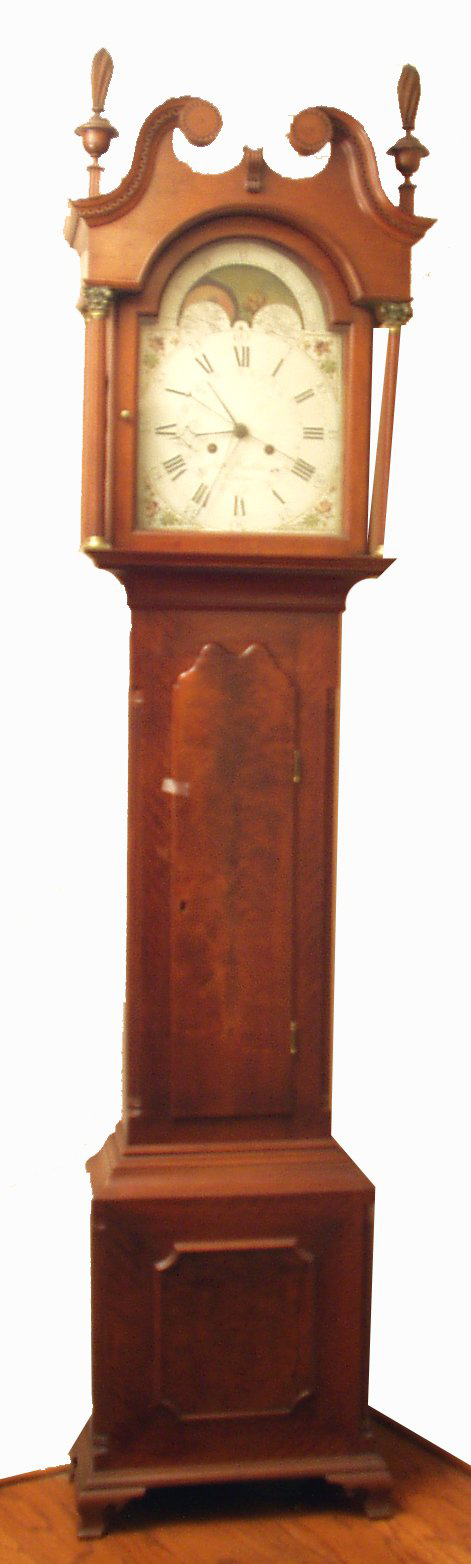 Jacob Hostetter of Hanover, Pa., crafted this Chippendale walnut tall case clock, which retains its original feet and likely its original finials. The estimate is $8,000-$12,000. Image courtesy Richard Opfer Auctioneering Inc.