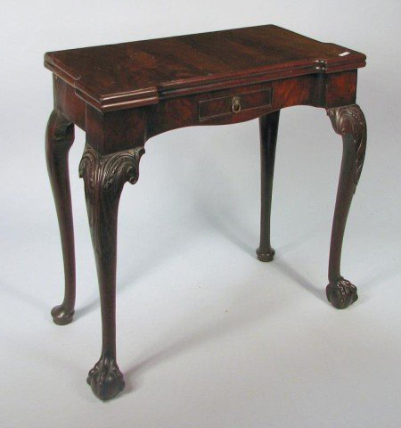 Four arched cabriole legs enhance this fine George III carved mahogany game table, which carries a $5,000-$7,000 estimate. Image courtesy Woodbury Auction LLC.