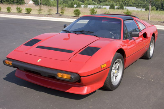 This bright red 1985 Ferrari 308 GTS Quattrovalvole, with just 49,013 miles, sped off for $24,150. Leland Little Auction & Estate Sales Ltd.