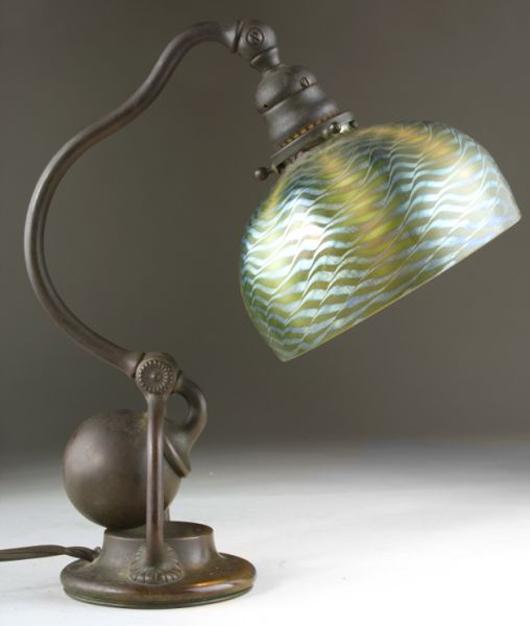 Tiffany Studios' counterbalance desk lamp with bronze base and green damascene shade made $8,050. Leland Little Auction & Estate Sales Ltd.