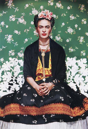 Nickolas Muray's iconic 1939 photograph of Frida Kahlo pictures the artist in a traditional Mexican dress. The carbon pigment print, which measures 14 3/4 by 10 1/8 inches, has a $10,000-$15,000 estimate. Image courtesy Phillips de Pury & Co.