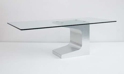 Architect Oscar Niemeyer designed this dining table for the firm Móveis Teperman Ltd., Brazil, circa 1990. Fabricated of glass and stainless steel-covered wood, the table has a $25,000-$35,000 estimate. Image courtesy Phillips de Pury & Co.