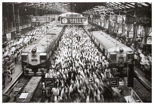 Economist turned photographer Sebastiao Salgado chose a slow shutter speed to blur the movements to people in 'Churchgate Station, Bombay, India.' The silver gelatin print, 21 1/4 by 32 inches, is dated 1995. It carries a $10,000-$15,000. Image courtesy Bloomsbury Auctions.