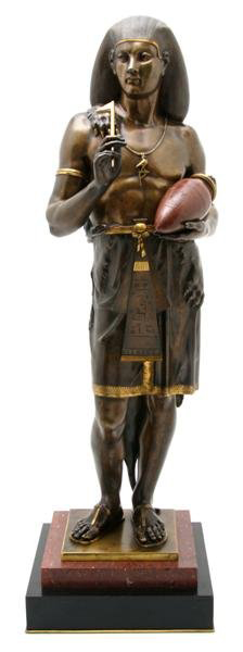 French sculptor Emile Louis Picault (1833-1915) created this 29 1/2-inch-high statue depicting an Egyptian scribe holding a stylus and a canopic jar. The figure is gilt bronze on a marble base. It has a $30,000-$50,000 estimate. Image courtesy Leslie Hindman Auctioneers Inc.