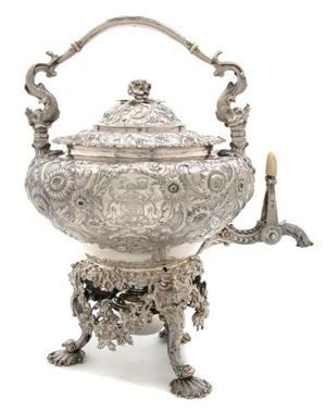 London silversmiths Storr & Mortimer crafted this George IV hot water kettle on stand in 1827. The body is decorated in floral repousse and engraved armorial crests. The kettle weighs 139 troy ounces. Image courtesy Leslie Hindman Auctioneers Inc.