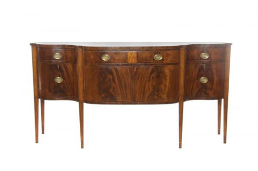 This mahogany sideboard having a banded serpentine top hails from Massachusetts. It measures an ample 80 inches wide, 40 inches tall and 23 inches deep. The estimate runs $5,000-$7,000.