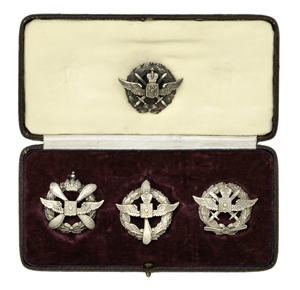 Four Russian pilots' badges and leather box with Imperial Russian Coat of Arms, estimated to sell for $5/7000 in Cowan's Nov. 4, 2009 Fall Firearms and Early Militaria Auction.