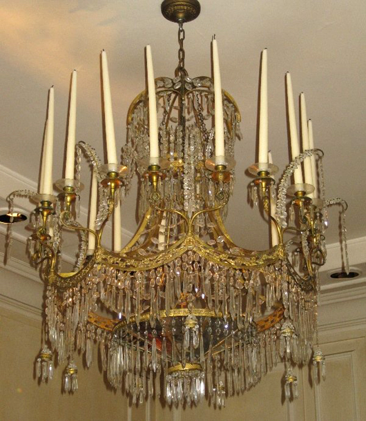 Baltic Neoclassical 20-light chandelier, gilt bronze and cut glass with suspending swags and 10 pairs of candles over a lower tier inset with mirrors, 45 inches high by 32 inches in diameter. Estimate $15,000-$25,000. Image courtesy LiveAuctioneers.com and Tepper Galleries.