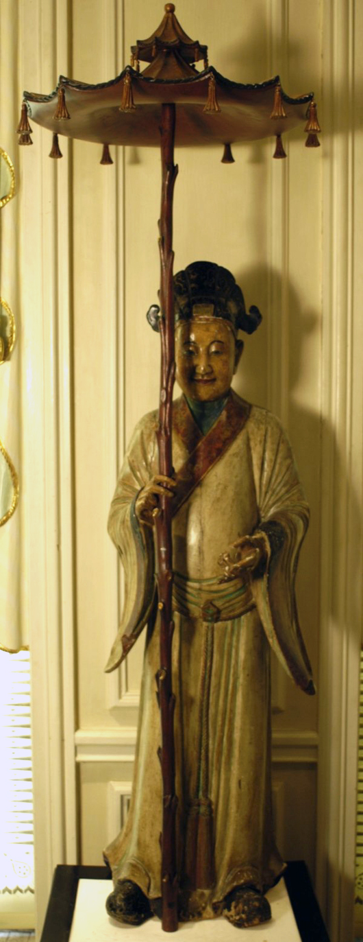 One of a pair of 18th/19th-century Chinese figures, male and female, 7 ft. 2½ inches tall, polychrome painted and carved wood with later addition of parasols, Brighton Pavilion manner, on gilt illuminated box-form bases. Estimate $25,000-$35,000 pair. Image courtesy LiveAuctioneers.com and Tepper Galleries.