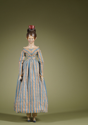 Important portrait-type carved-wood doll, Germany, circa 1820, 39 inches. Richard Wright is believed to have acquired the doll via private treaty sale through Sotheby's London in the 1980s. Undocumented anecdotal history purports that the doll was commissioned by a member of the Dutch Royal Family. Estimate $40,000-$60,000. Image courtesy Skinner Inc.
