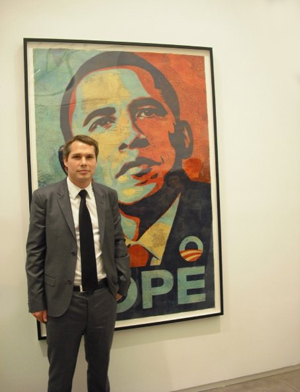 Shepard Fairey posed with the 'HOPE' poster at the Institute of Contemporary Art in Boston last February. Image courtesy Wikimedia Commons.