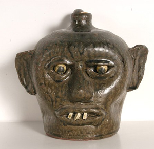 The teeth in this face jug made by Lanier Meaders (1917-1998) are pieces of a china plate. Made in 1968, the jug has a $3,000-$5,000 estimate. Image courtesy of Slotin Folk Art.