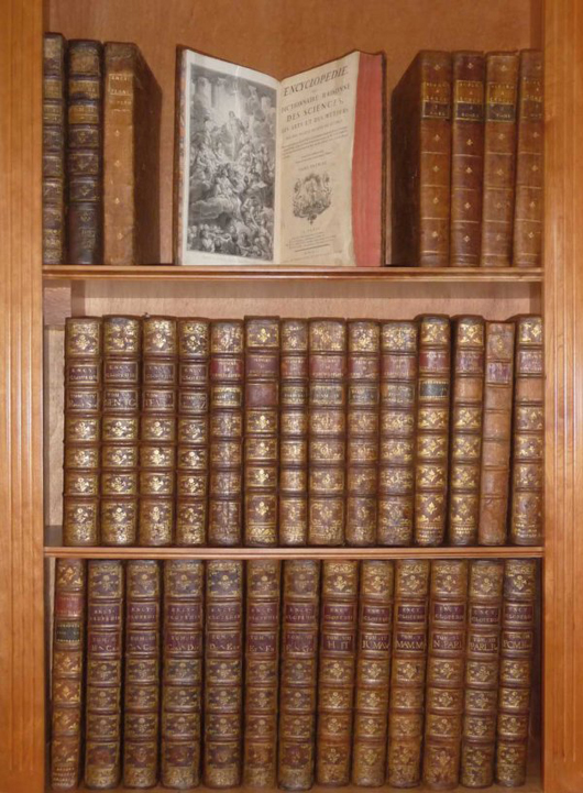The world's first encyclopedia, the Encyclopédie of Diderot and d'Alembert, from 1787, containing 35 folio volumes. Estimate $37,500-$52,500. Image courtesy Adams Amsterdam Auctions and LiveAuctioneers.com.