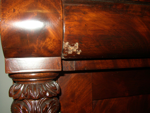 The front of this drawer has been damaged. It would take too long to determine if it is simply finish damage or if the veneer is also damaged. Just be aware of it.