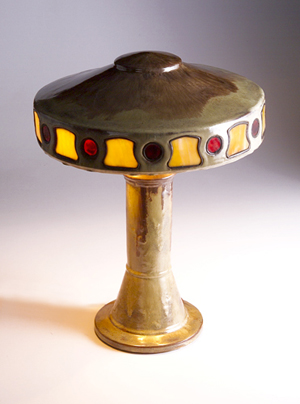 Bearing both Fulper and Vase-Kraft stamped marks, this pottery table lamp is a rare find. The shade contains red and yellow leaded slag glass inserts. Image courtesy of Rago Arts and Auction Center and Live Auctioneers Archive.