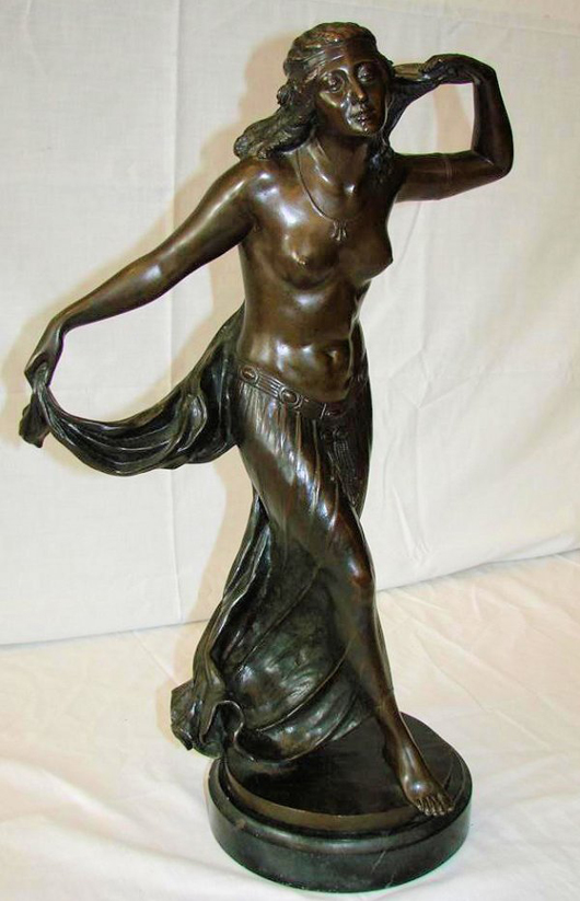 Standing on a black marble plinth, this bronze statue by M. Valentin stands 22 inches high. It has a $2,000-$3,000 estimate. Image courtesy of Professional Appraisers & Liquidators.
