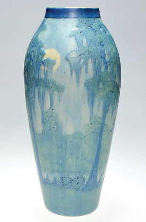 Newcomb artist Anna Frances Simpson painted a full moon shining through a bough of a cypress tree on this 13 7/8-inch-tall vase. Dated in code for 1918, the vase has an $8,000-$10,000 estimate. Image courtesy Cincinnati Art Galleries.