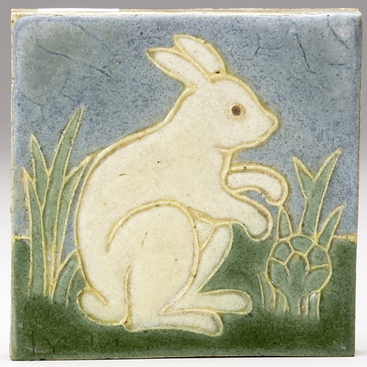 A decorative Grueby tile with an ivory rabbit in a cabbage field sold in September for $1159. Courtesy Rago Arts and Auction Center