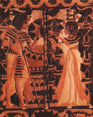 Tutankhamun receives flowers from his queen, Ankhesenamun. The image is on the lid of a box found in Tut's tomb. Courtesy of Wikimedia Commons.