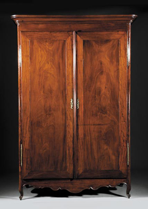 Southern furniture in Neal Auction Co.'s annual sale includes this important Louisiana carved mahogany and cypress armoire from the late 18th century or early 19th century. Standing 89 1/2 inches high and 62 1/2 inches wide, the armoire has a $10,000-$15,000 estimate. Image courtesy of Neal Auction Co.