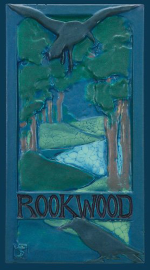 Rookwood Faience tile showing the Rookwood company name and two rooks in flight in a dense forest, designed circa 1905 by Sally Toohey, 14 inches by 8 inches, sold for $85,000 on June 3, 2007 at Cincinnati Art Galleries. Image courtesy LiveAuctioneers.com Archive and Cincinnati Art Galleries.