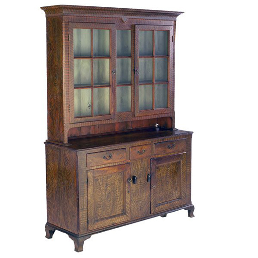 Grain painting enhances this Pennsylvania Dutch cupboard, which has a $10,000-$15,000 estimate. Image courtesy of Rago Arts and Auction Center.