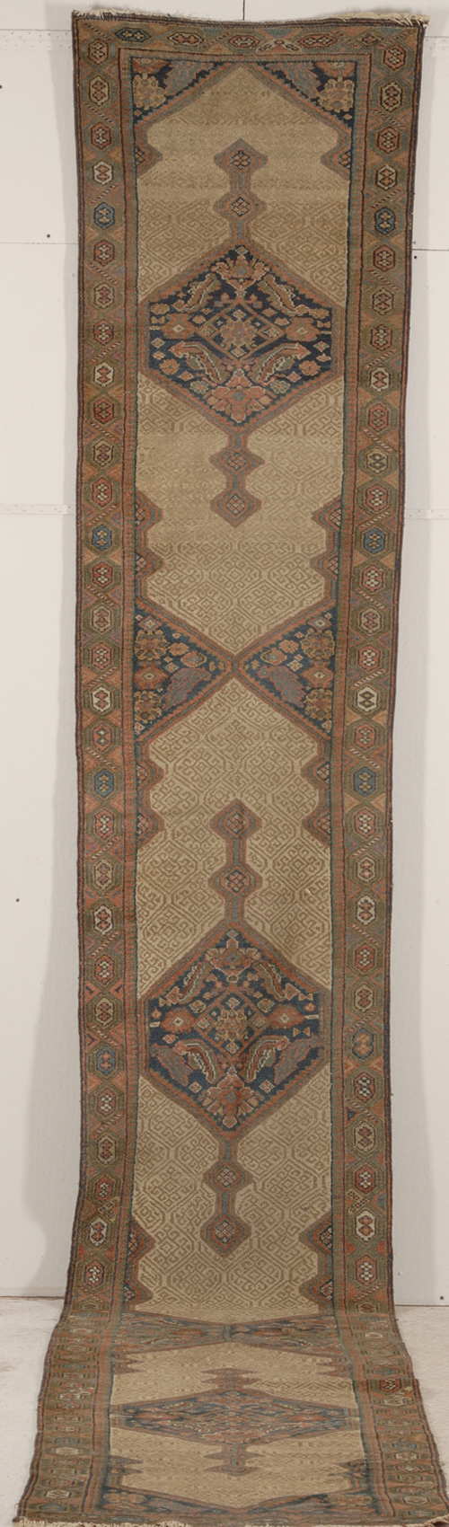 John Lennon and Yoko Ono once owned this Serab runner, which is 17 feet long. It was made in northwest Persia in the last quarter of the 19th century. The lot includes certificate of ownership. Image courtesy Skinner Inc.