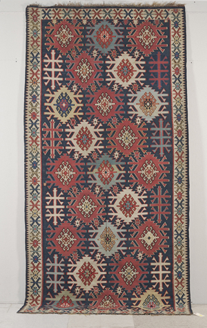 This distinctive Kuba Kelim rug, 11 feet by 5 feet 7 inches, was woven in northeast Caucasus in the last quarter of the 19th century. It has a $6,000-$8,000 estimate. Image courtesy Skinner Inc.