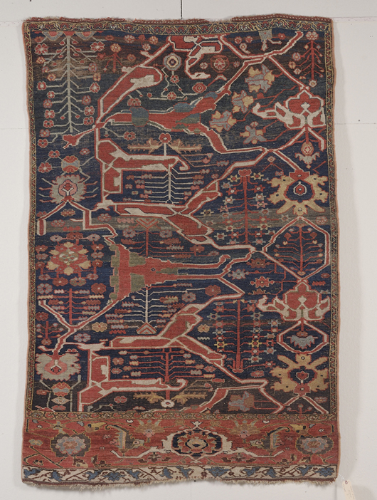 From the Milton H. Crouch collection is this Garrus Bidjar sampler. which is 6 feet 10 inches x 4 feet 8 inches. It was woven in northwest Persia in the second half of the 19th century. The estimate is $7,000-9,000. Image courtesy Skinner Inc.