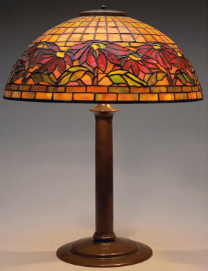 The Poinsettia shade on this signed Tiffany Studios table lamp is 18 inches in diameter. The lamp is expected to sell for $45,000-$55,000. Image courtesy Treadway Gallery.