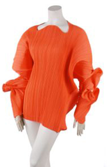 An Issey Miyake orange pleated minidress, sewn using only one seam, sold for $2,196 at Leslie Hindman's April 19, 2009 auction of vintage couture and accessories, against a pre-sale estimate of $700-$900. Image courtesy of Leslie Hindman Auctioneers.
