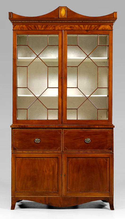 An important circa 1800 Charleston Federal inlaid china press is expected to bring $30,000-$50,000. Note the large conch shell on the removable arched cornice. The lower case contains a fitted butler's desk. Image courtesy of Brunk Auctions.