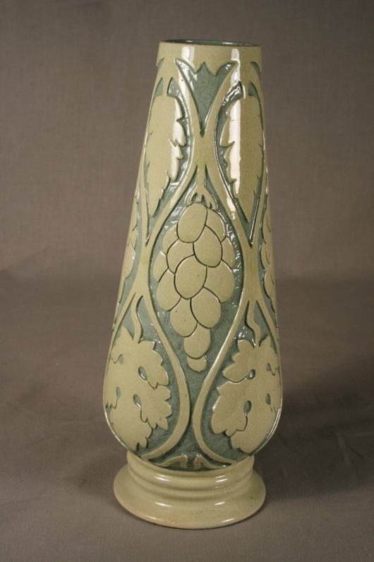 Frederick H. Rhead developed the concept for Roseville's Della Robbia line circa 1904. This 11-inch carved vase has a $3,000-$5,000 estimate. Image courtesy Mathesons' AA Auctions.