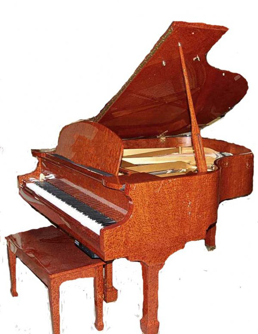 This Falcone baby grand piano in a beautiful burl case is equipped with a piano disc remote player system. It has an $8,000-$12,000 estimate. Image courtesy of Four Seasons Auction Gallery.