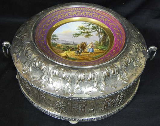 A museum's letter of authenticity is included with this rare Napoleon III biscuit box. Topped with a Sevres center plate, 13 1/2-inch diameter embossed box has a $2,000-$5,000 estimate. Image courtesy of Four Seasons Auction Gallery.