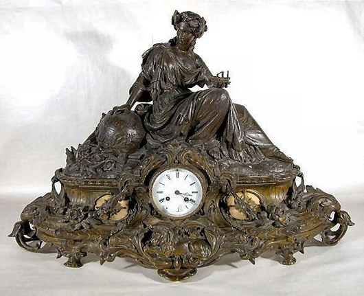 Industry is celebrated in this massive French figural clock that is 21 1/2 inches tall by 32 inches wide. Though not in running condition, this clock is expected to sell for $1,000-$3,000. Image courtesy Tom Harris Auctions.