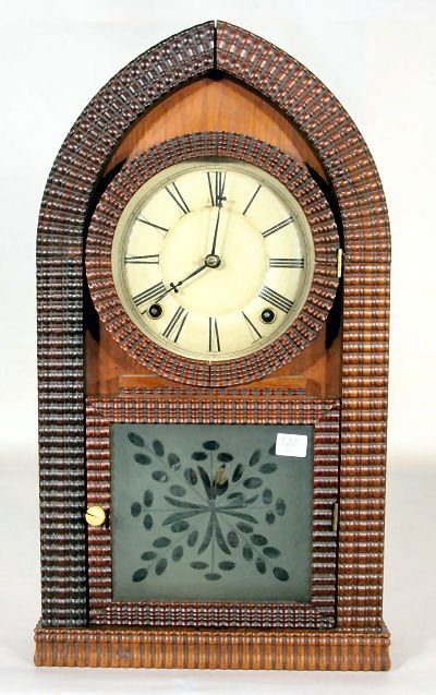 A label on the inside of this ripple-front beehive clock states: 'Made by E.N. Welch at the Old Establishment and Late J.C. Brown.' It stands 18 3/4 inches tall. It has a $1.,000-$2,500 estimate. Image courtesy Tom Harris Auctions.