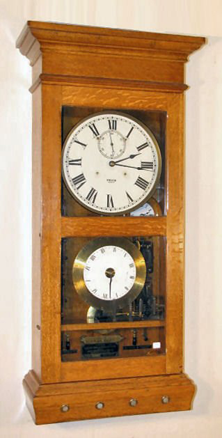 Landis Engineering Manufacturing Co. of Waynesboro, Pa., manufactured this Frick Electric Time and Program Clock in a 44-inch-tall golden oak case. It is expected to sell for as much as $2,000. Image courtesy Tom Harris Auctions.