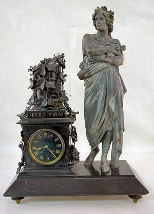Standing 24 inches tall, this French statue clock is in running order and has a $1,000-$3,000 estimate. Image courtesy Tom Harris Auctions.