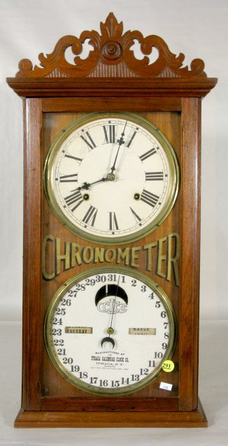 An unspecified repair will be needed to get this Ithaca No.10 Farmer's Calendar Clock with eight-day time and strike movement running again. The 25 1/4-inch-high walnut case is in good condition. It has a $750-$2,500 estimate. Image courtesy Tom Harris Auctions.