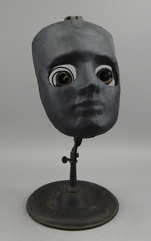 Medical students used the ophthalmophantome to hone their surgical skills. The black composition face is 8 inches high. The device has an $800-$1,200 estimate. Image courtesy of Myers Fine Art & Antiques Auction Gallery.