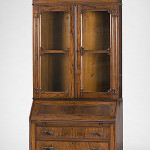 The consignor purchased this secretary bookcase across the Ohio River from Cincinnati in 1988. It features an arched crown of carved fruit and flowers and a fitted interior with bird's-eye maple trim. It stands 84 inches high and 40 inches wide. The estimate is $1,000-$1,200. Image courtesy Cowan's Auctions Inc.