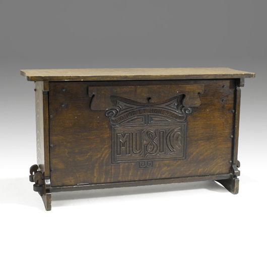 Charles Rohlfs' mark, an 'R' carved within a bow saw, is on the back of this exceptional music cabinet. It measures 20 inches high, 36 inches long and 11 1/2 inches deep. It has a $7,000-$10,000 estimate. Image courtesy Rago Arts and Auction Center.