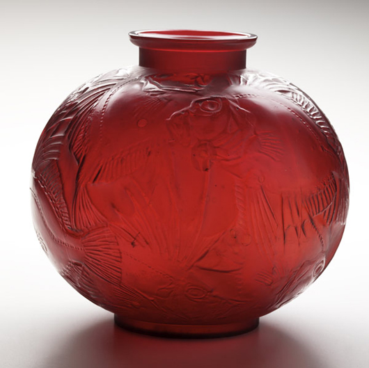 Lalique's Poissons deep red glass vase dates to the early 1920s. It is 9 1/2 inches high and 9 1/2 inches in diameter. It has a $17,000-22,000 estimate. Image courtesy Rago Arts and Auction Center.