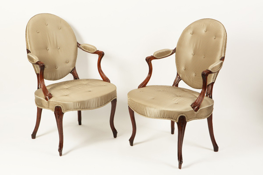 Two George III mahogany armchairs in the French Hepplewhite style, circa 1780, are priced £8,750 ($14,200) by Guy Dennler Antiques & Interiors at the Tortworth Court Antiques and Fine Art Fair in the Cotswolds on Feb. 26-28. Photo Antiques Dealers Fair Ltd.