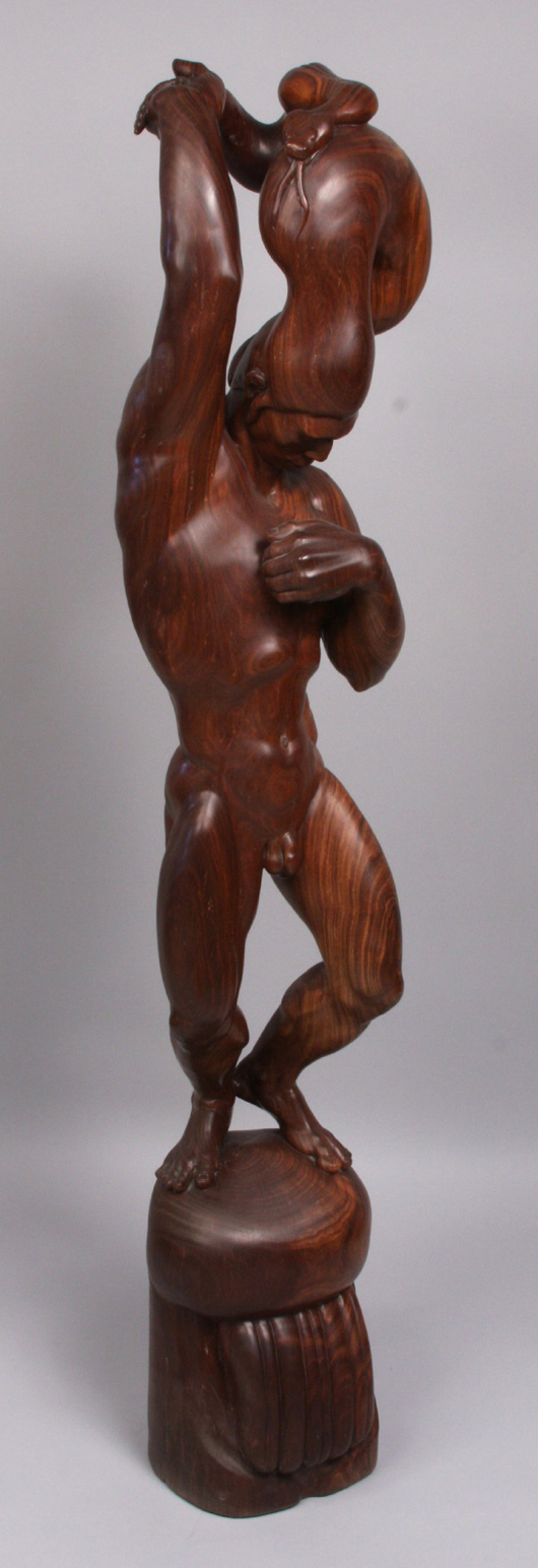 Donal Hord sculpted 'Summer Rain'of lignum vitae, a dense, tropical hardwood. The figure, which is 48 3.4 inches tall, sold for $31,050. Image courtesy of Kaminski Auctions.