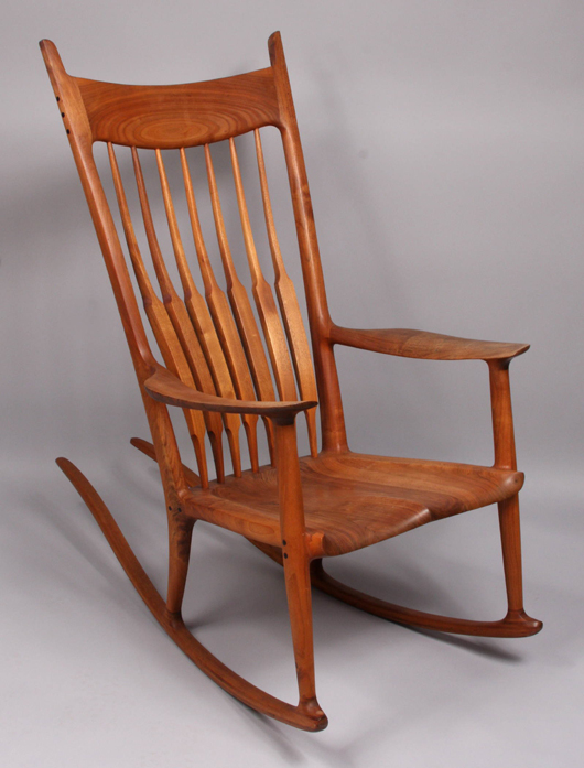 Signed, numbered and dated on base, the Sam Maloof teakwood rocking chair crept above to high estimate, selling at $31,050. Image courtesy of Kaminski Auctions.