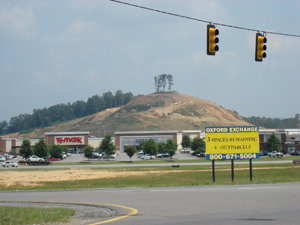 This mound in Oxford, Ala., which many believe was built by Native Americans more than 1,000 years ago, is the subject of a dispute with developers who want to level it to use as fill for the construction of a Sam's Club. Image copyright Ginger Ann Brook, used by permission.