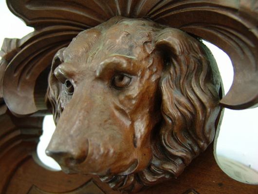Close-up shows the carved dog's head on the Gilbert one-weight regular. Image courtesy of Dirk Soulis Auctions.