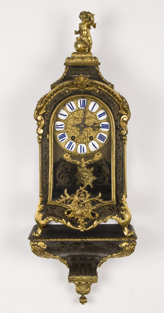 Dating to the second half of the 19th century, this French boulle cased bracket clock in an ormolu mounted case stands atop its matching wall bracket. The clock, which has a two- train brass movement striking on a wire gong, sold for $1,900 in September. Image courtesy of Dallas Auction Gallery.